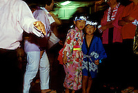 Children wearing traditional clothing (one has kimono) at Bon Dance Festival at Hongwanji Temple in Kealakekua, Kona, Hawaii.
