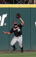 Nebraska outfielder Mojo Hagge (39) forces an out, Monday, June 7, 2021 in the third inning of the NCAA Fayetteville Regional at Baum-Walker Stadium in Fayetteville. Check out nwaonline.com/210608Daily/ for today's photo gallery. <br /> (NWA Democrat-Gazette/Charlie Kaijo)