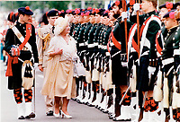 Her majesty the Queen Mother arrives in Montreal on Thursday afternoon. She is inspecting the guard of honor provided by the black watch royal highland regiment of Canada.