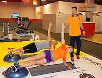 Februari 04, 2015, Apeldoorn, Omnisport, Fed Cup,  Netherlands-Slovakia, Fitness trainer  Miguel Janssen with Kiki Bertens (NED) and Michaella Krajicek (forground)<br /> Photo: Tennisimages/Henk Koster