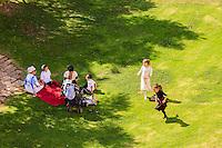 Israel,Jerusalem, orthodox judish children play in the garden beside the old city walls