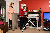 FAO: Society <br /> Pictured L-R: Alys Phillips helping resident Sharon Wieland iron clothes<br /> Re: Care worker Alys Phillips, 23, who looks after people with learning disabilities in Brecon, mid Wales, UK. Wednesday 01 February 2017