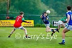 Laune Rangers Eoghan Hassett spreads the ball across the Kilcummin goalmouth as Kilcummins keeper Robbie Moynihan closes down his angle of opportunity in the opening round of the County MFL on Monday evening.