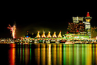 Vancouver, BC, British Columbia, Canada - Christmas Lights and New Year's Eve Fireworks at Canada Place Trade and Convention Centre - Port of Vancouver Harbour