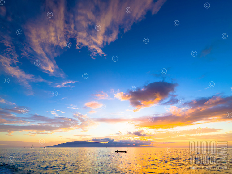 A brilliant Hawaiian sky as the sun sets behind Lana'i, as seen from Ka'anapali Beach, Maui.