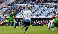 Ashley Williams of Swansea City shoots at goal during the Barclays Premier League match between Newcastle United and Swansea City played at St. James' Park, Newcastle upon Tyne, on the 16th April 2016