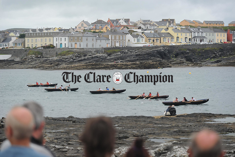 Currachs line up in Kilkee bay for one of the races during the Kilkee Maritime Festival. Photograph by John Kelly.