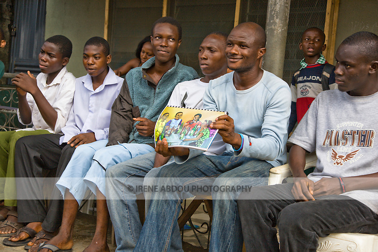 A young man in Lagos, Nigeria, talks to his out-of-school peers about HIV prevention, using educational materials designed for low literacy audiences by the Society for Family Health (SFH).   SFH is Nigeria's largest indigenous non-profit and affiliate of the international social marketing organization, Population Services International (PSI).
