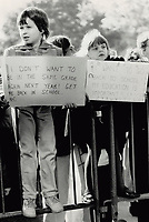 1987 FILE PHOTO - ARCHIVES -<br /> <br /> Schoolchildren join their parents at Queen's Park yesterday to protest the continuation of the Metro public elementary teachers' strike. A tentative agreement was reached in the dispute last night but in the afternoon about 250 people tried to demonstrate in Premier David Peterson's office. They were turned back by police and security guards.<br /> <br /> 1987<br /> <br /> PHOTO :  Erin Comb - Toronto Star Archives - AQP