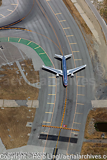 aerial photograph American Airlines Boeing 737 airliner taxiing for take off runway 1L San Francisco International Airport SFO