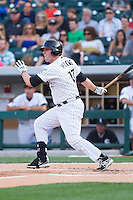 Andy Wilkins (17) of the Charlotte Knights follows through on his swing against the Lehigh Valley IronPigs at BB&T Ballpark on May 8, 2014 in Charlotte, North Carolina.  The IronPigs defeated the Knights 8-6.  (Brian Westerholt/Four Seam Images)