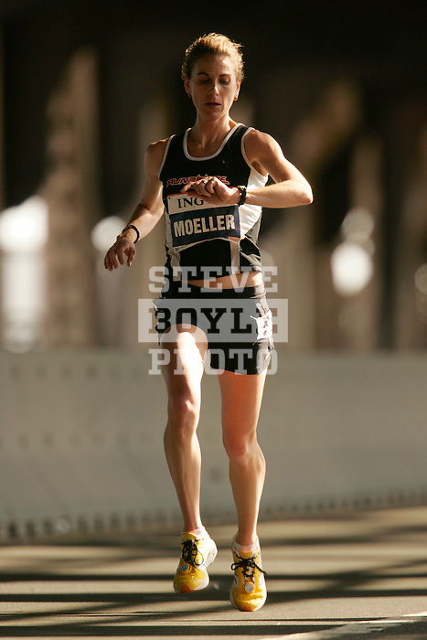 Erin Moeller (USA) checks her watch as she crosses the 16-mile mark on the Queensboro Bridge from Queens into Manhattan while competing in the ING New York City Marathon in New York, New York on November 4, 2007.  Martin Lel (KEN) won the men's race with a time of 2:09:04  Paula Radcliffe (GBR) won the women's race with a time of 2:23:09.