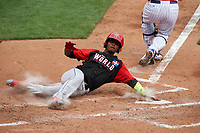 World Team Raimel Tapia (15) slides home during the MLB All-Star Futures Game on July 12, 2015 at Great American Ball Park in Cincinnati, Ohio.  (Mike Janes/Four Seam Images)