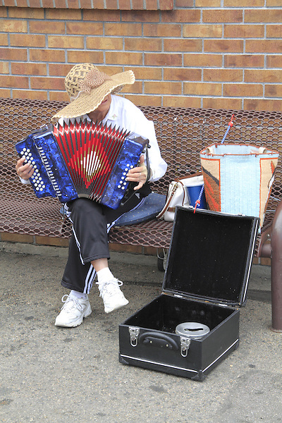 Woman plays accordian for donations Denver, Colorado. .  John offers private photo tours in Denver, Boulder and throughout Colorado. Year-round Colorado photo tours.