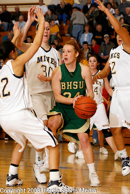 RAPID CITY, SD - JANUARY 15 --  Katelyn Lamb #24 of Black Hills State gets surrounded by S.D. Tech defenders during their game Thursday evening at Goodell Gymnasium.  (Photo by Dick Carlson/Inertia)