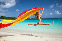 Alex Krasny former gymnast running with red scarf.Trunk Bay.Virgin Islands National Park.St. John.U.S. Virgin Islands