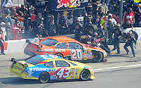 Sept. 28, 2008; Kansas City, KS, USA; Nascar Sprint Cup Series driver Tony Stewart (20) runs into the gas man on the pit crew of Brian Vickers (not pictured) as Bobby Labonte (43) drives by on pit road during the Camping World RV 400 at Kansas Speedway. Mandatory Credit: Mark J. Rebilas-