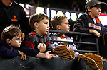 Young children beg for autographs from professional baseball players in San Francisco, California.