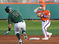 Jacob German (12) of the University of Alabama-Birmingham Blazers is out at second as second baseman Jay Baum (13) of the Clemson Tigers turns the first half of a double play to end the fifth inning of a game on Feb. 17, 2012, at Doug Kingsmore Stadium in Clemson, South Carolina. (Tom Priddy/Four Seam Images)