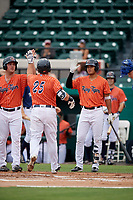 Lakeland Flying Tigers designated hitter Wade Hinkle (46) high fives a teammate after they scored a run during the second game of a doubleheader against the St. Lucie Mets on June 10, 2017 at Joker Marchant Stadium in Lakeland, Florida.  Lakeland defeated St. Lucie 9-1.  (Mike Janes/Four Seam Images)