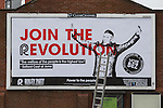 © Joel Goodman - 07973 332324 .  12/01/2015 . Salford , UK . The campaign advert . Bez ( Mark Berry ) launches his parliamentary campaign for the constituency of Salford and Eccles at a poster site on Chapel Street , Salford . Bez , the freaky dancer from Madchester band The Happy Mondays , is standing for The Reality Party . Seat incumbent , Labour's Hazel Blears , is standing down at the 2015 election . Photo credit : Joel Goodman