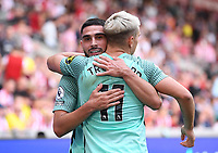 11th September 2021; Brentford Community Stadium, London, England;  Premier League football, Brentford versus Brighton Athletic; Leandro Trossard and Neal Maupay of Brighton embrace on the final whistle with Brighton winning 0-1