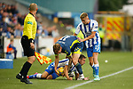 A fracas by the touchline as Cameron Salkeld of Ayr attempts to retrieve the ball from Brandon Haunstrup of Kilmarnock. Kilmarnock 2 Ayr United 0, Scottish Championship, August 2nd 2021. Following Kilmarnock's relegation in 2020-21, the first game of the new season is the Ayreshire Derby, the first league match between the teams in 28 years. Due to relaxation of Covid restrictions the match was played in front of a crowd of 3200 Kilmarnock fans. The game was shown live on BBC Scotland.