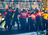 Oct 4, 2020; Madison, Illinois, USA; Crew members for NHRA top fuel driver Doug Kalitta celebrate after winning the Midwest Nationals at World Wide Technology Raceway. Mandatory Credit: Mark J. Rebilas-USA TODAY Sports