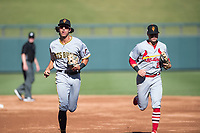 Surprise Saguaros shortstop Cole Tucker (2), of the Pittsburgh Pirates organization, and second baseman Andy Young (29), of the St. Louis Cardinals organization, jog off the field during an Arizona Fall League game against the Salt River Rafters at Salt River Fields at Talking Stick on November 5, 2018 in Scottsdale, Arizona. Salt River defeated Surprise 4-3 . (Zachary Lucy/Four Seam Images)