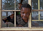 Mar. 12, 2013; A boy looks out a window at a child care center in the Dube Hostel in Johannesburg, South Africa...Photo by Matt Cashore/University of Notre Dame