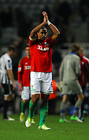 Saturday 17 November 2012<br /> Pictured L-R: Ashley Williams of Swansea thanks away supporters after the final whistle.<br /> Re: Barclay's Premier League, Newcastle United v Swansea City FC at St James' Park, Newcastle Upon Tyne, UK.