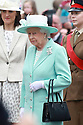 Britain's Queen Elizabeth II and the Duke of Edinburgh  (unseen) gather outside the Coleraine town hall to pay their respects to the dead of World War 1as they finish their three day tour of Northern Ireland, Wednesday June 25, 2014. Photo/Paul McErlane
