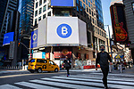 Electronic billboards display Bitcoin and Coinbase Global Inc. signage during the company's initial public offering (IPO) outside of the Nasdaq MarketSite in New York, U.S., on Wednesday, April 14, 2021. Photograph by Michael Nagle
