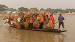 Dozens of workers cram onto small boat during fishing festival  by Hedayet Sarker