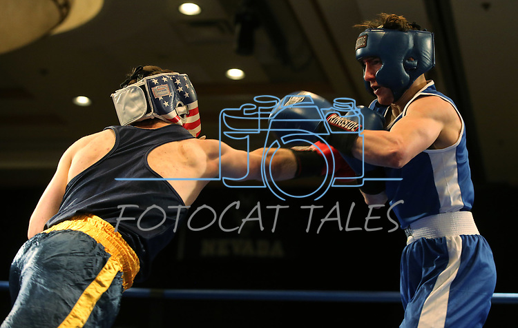 Nevada boxer Tyler Poalillo and David Babayan, of Cal, compete in the National Collegiate Boxing Association action in Reno, Nev. on Friday, Jan. 31, 2020. Babayan won the bout. <br /> Photo by Cathleen Allison