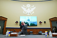 Director of the National Institute for Allergy and Infectious Diseases Dr. Anthony Fauci puts on a Washington Nationals face mask when he arrives to testify before the House Committee on Energy and Commerce on the Trump Administration's Response to the COVID-19 Pandemic, on Capitol Hill in Washington, DC on Tuesday, June 23, 2020.    <br /> Credit: Kevin Dietsch / Pool via CNP/AdMedia