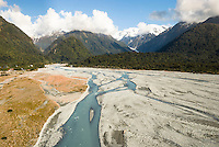 Aerial views of Waiho River with Franz Josef Glacier valley in distance, Westland National Park, World Heritage Area, West Coast, New Zealand