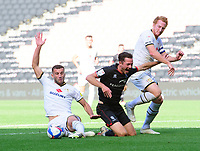 Lincoln City's Tom Hopper is fouled by Milton Keynes Dons' Baily Cargill for a penalty<br /> <br /> Photographer Chris Vaughan/CameraSport<br /> <br /> The EFL Sky Bet League One - Milton Keynes Dons v Lincoln City - Saturday 19th September 2020 - Stadium MK - Milton Keynes<br /> <br /> World Copyright © 2020 CameraSport. All rights reserved. 43 Linden Ave. Countesthorpe. Leicester. England. LE8 5PG - Tel: +44 (0) 116 277 4147 - admin@camerasport.com - www.camerasport.com