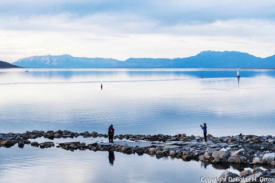 Great Salt Lake, Utah.  Viewed from Great Salt Lake State Park, Salt lake City area.  A popular tourist stop.  Sailing on calm waters.  Anelope Island in background.