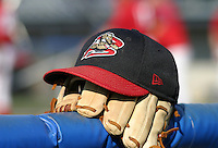 August 28, 2003:  Hat and glove of the Batavia Muckdogs during a game at Dwyer Stadium in Batavia, New York.  Photo by:  Mike Janes/Four Seam Images