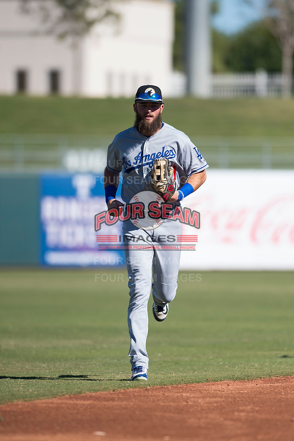 Glendale Desert Dogs right fielder Cody Thomas (40), of the Los Angeles Dodgers organization, jogs off the field between innings of an Arizona Fall League game against the Surprise Saguaros at Surprise Stadium on November 13, 2018 in Surprise, Arizona. Surprise defeated Glendale 9-2. (Zachary Lucy/Four Seam Images)