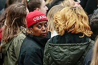 "An African American woman wears an ""Obama 4 More Years"" knit hat in a crowd."