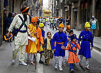 Indian festival in Ramblas Catalunya area called Vaisakhi.  These are Sikhs from Punjab that started a procession in Ramblas Raval and carried it thru Ramblas Catalunya and ended at the Plaza St. Augustine. One of the leaders of this is a guy named S. Singh Purewal.  The festival includes the passing out of huge amounts of food.  The men in the street just off the Ramblas hauled cart after shopping cart of fresh fruit and passed it out to the general public.