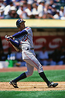 OAKLAND, CA - Roberto Alomar of the Cleveland Indians bats during a game against the Oakland Athletics at the Oakland Coliseum in Oakland, California in 2000. (Photo by Brad Mangin)