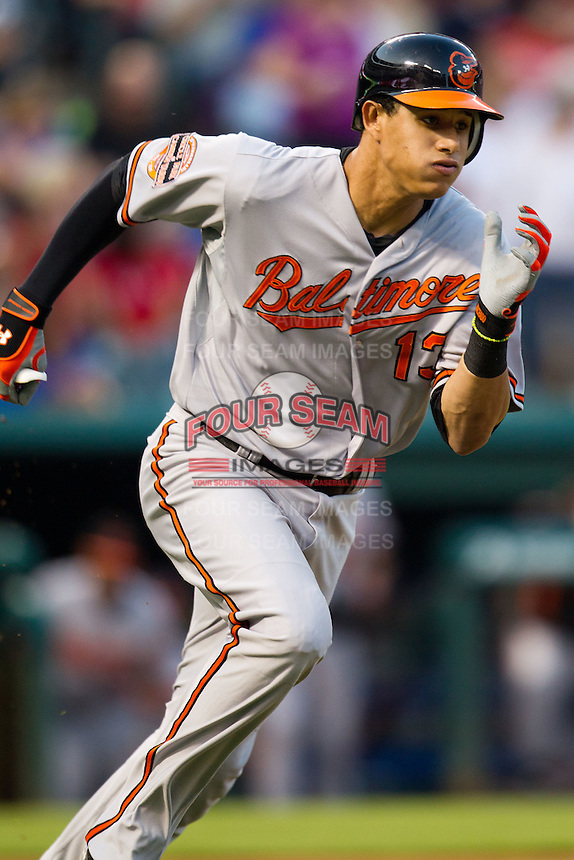Baltimore Orioles third baseman Manny Machado #13 runs to first base during the Major League Baseball game against the Texas Rangers on August 21st, 2012 at the Rangers Ballpark in Arlington, Texas. The Orioles defeated the Rangers 5-3. (Andrew Woolley/Four Seam Images).