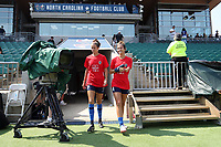 CARY, NC - SEPTEMBER 12: Havana Solaun #19 and Carson Pickett #4 of the North Carolina Courage take the field before a game between Portland Thorns FC and North Carolina Courage at Sahlen's Stadium at WakeMed Soccer Park on September 12, 2021 in Cary, North Carolina.