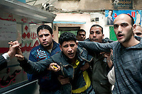 A young man injured by a tear gas canister fired by police is treated by a paramedic on a back street of Cairo. Continued anti-government protests take place in Cairo calling for President Mubarak to stand down. After dissolving the government, Mubarak still refuses to step down from power.