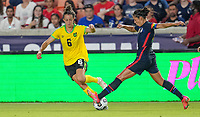 HOUSTON, TX - JUNE 13: Carli Lloyd #10 of the United States and Havana Solaun #6 of Jamaica meet during a game between Jamaica and USWNT at BBVA Stadium on June 13, 2021 in Houston, Texas.