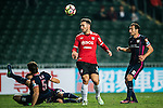 Muangthong United Forward Xisco Jimenez (c) fights for the ball with SC Kitchee Defender Helio de Souza (l) during the 2017 Lunar New Year Cup match between SC Kitchee (HKG) vs Muangthong United (THA) on January 28, 2017 in Hong Kong, Hong Kong. Photo by Marcio Rodrigo Machado/Power Sport Images
