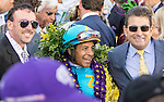 October 31, 2015 : American Pharoah jockey Victor Espinoza (center), exercise rider Georgie Alvarez (left) and assistant trainer Jimmy Barnes (right) in the winner's circle after winning the Breeders' Cup Classic (Grade I) in Lexington, Kentucky on October 31, 2015.  Sue Kawczynski/ESW/CSM